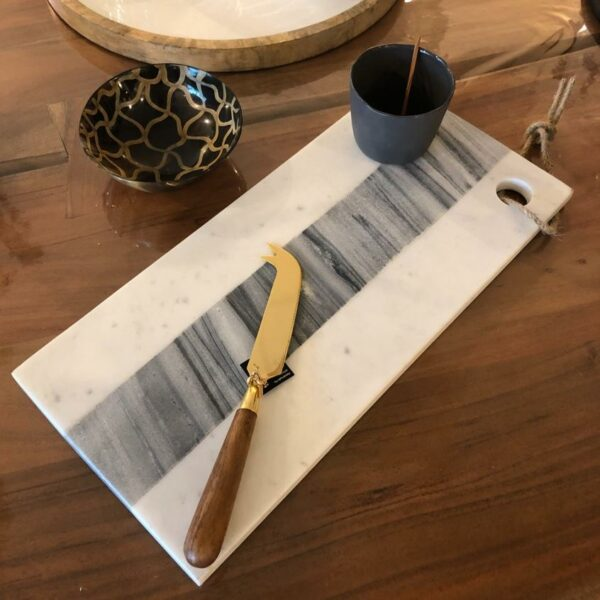 Couteau à fromage doré et bois