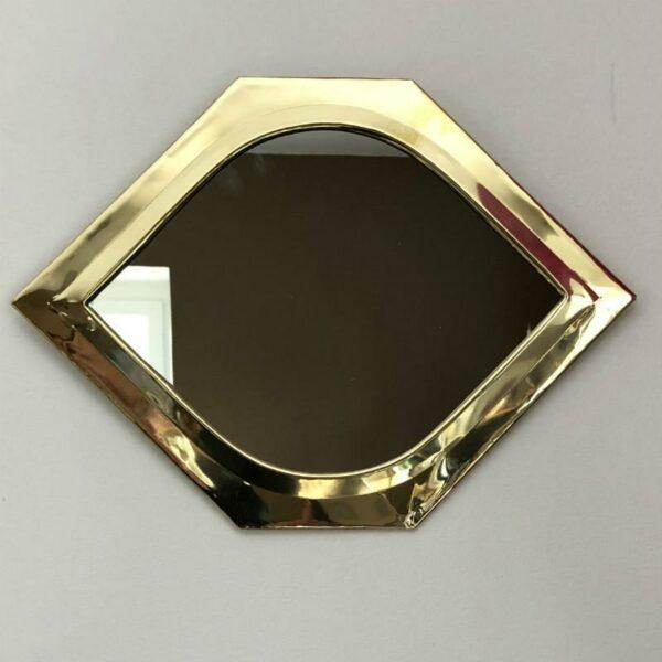 miroir forme oeil doré de chez choufmoi